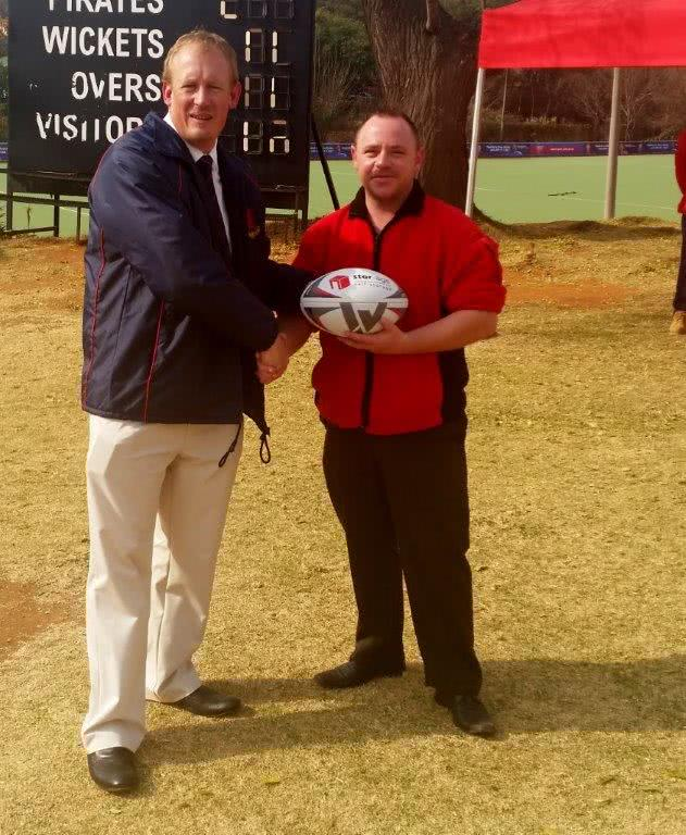 Andreas from Stor-Age hands ball to Pirates Rugby Club