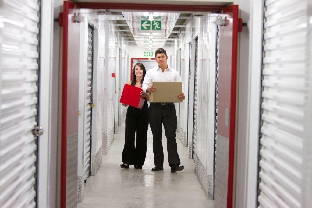 Customers in self storage hallway