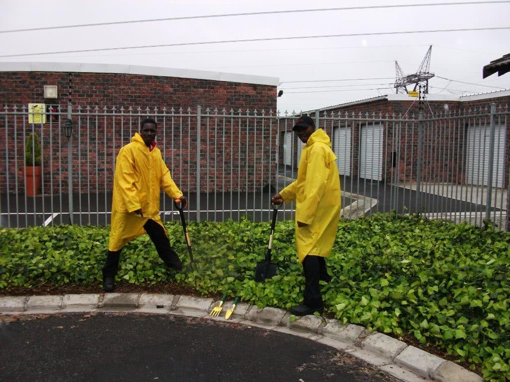 Stor-Age staff gardening in the rain