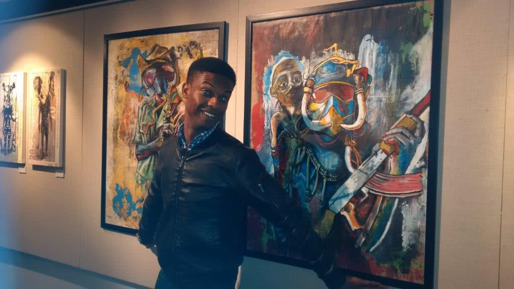 Mawande Mase with artwork at Gfi Art Gallery