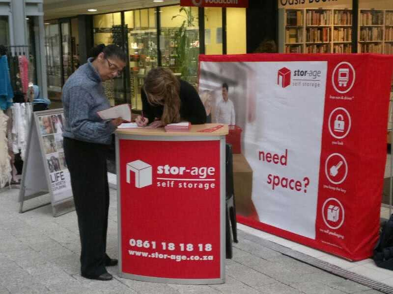 Stor-Age Self Storage promotion stand at Old Mutal food court