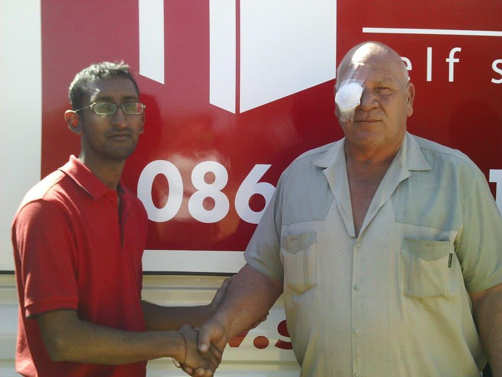 Stor-Age Operations Manager Avwar Nepal handing over the goods to Maranata founder Daan Lensley